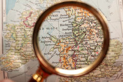 Magnifying glass and map Stock Photography