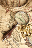 Magnifying glass, map and Gold Nugget Royalty Free Stock Images