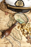 Magnifying glass, map and Gold Nugget stock image