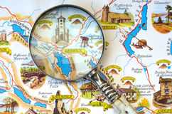 Magnifying glass on map of the Lake District. Stock Photos