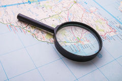 Magnifying glass on the map Stock Photo