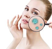 Magnifying glass with microbes on female face. Isolated on white. Causative agents of acne concept Stock Image