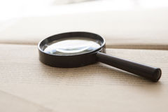 Magnifying glass. On middle of newspaper stock photos