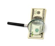 Magnifying glass on money Stock Photos