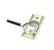 Magnifying glass on money Royalty Free Stock Photos