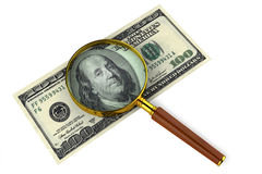 Magnifying glass on money Stock Photo