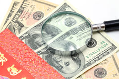 Magnifying glass on Money Stock Images