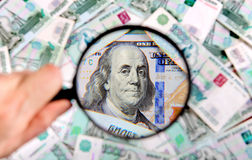 Magnifying Glass on the Money Stock Photo