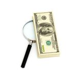 Magnifying glass on money background Stock Images