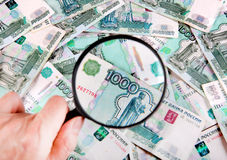 Magnifying Glass on the Money Stock Photos