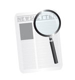 Magnifying glass and newspaper Stock Photography