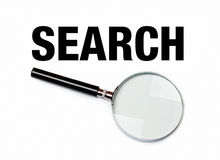 Magnifying glass next to search word. Magnifying glass and search word on white blank background Stock Photography