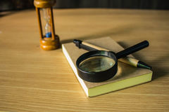 Magnifying glass on notebook Royalty Free Stock Photo