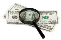 Magnifying glass on the notes of a hundred dollars Royalty Free Stock Photography