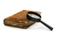 Magnifying glass and old book Stock Photography
