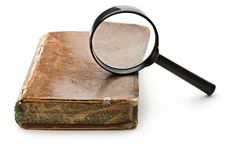 Magnifying glass and old book Royalty Free Stock Photos