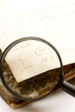 Magnifying glass and old book Stock Photo