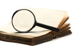 Magnifying glass and old book Royalty Free Stock Images