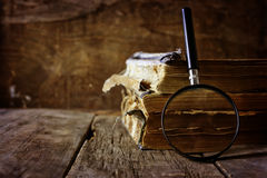 Magnifying glass and old book Stock Image