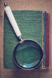 Magnifying Glass with old Books on Vintage Background with Insta Royalty Free Stock Images