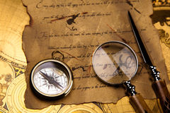 Magnifying glass and old map, colorful bright journey theme Royalty Free Stock Photography