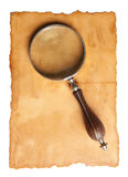 Magnifying glass and old paper Royalty Free Stock Photo