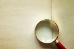 Magnifying Glass On Old Paper Stock Images