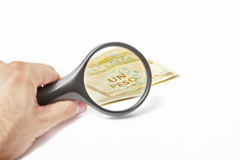 Magnifying Glass on the one One Cuban Pesos.  Royalty Free Stock Images