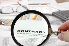 Magnifying Glass Over Contract Papers Stock Photography