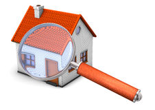 Magnifying glass over house Stock Images