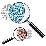 Magnifying glass over a labyrinth Royalty Free Stock Images