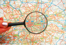 Magnifying glass over the map Stock Photos