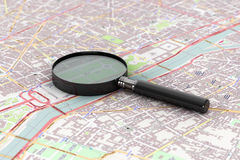 Magnifying Glass over the Map Stock Images