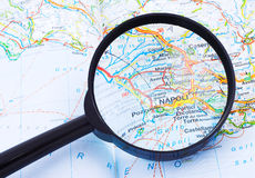 Magnifying glass over Napoli, Italy map. Magnifying glass over Napoli on the Italy map suggesting the destination under examination Royalty Free Stock Image