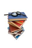 Magnifying glass over the stack of books. Magnifying glass over the stack  of books Royalty Free Stock Image