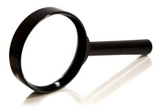 Magnifying glass over white background Royalty Free Stock Photo
