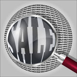 Magnifying glass over the word SALE. Stock Images