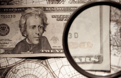 Magnifying glass and paper currency Royalty Free Stock Photo