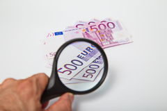 Magnifying Glass on the paper five hundred Euros. Magnifying Glass on the five hundred Euros Royalty Free Stock Photo