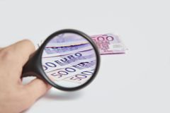 Magnifying Glass on the paper five hundred Euros. Magnifying Glass on the five hundred Euros Stock Photo