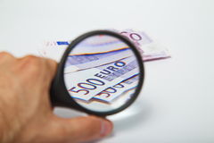 Magnifying Glass on the paper five hundred Euros Stock Photos