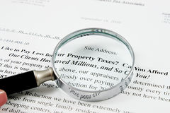 Magnifying Glass on paper from tax assosiates Royalty Free Stock Photos