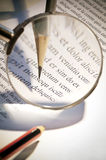 Magnifying glass and pen. Image of the increase with a magnifying glass of the top of a pencil that this checking text Stock Photos