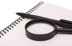 Magnifying Glass,Pen And Notebook Royalty Free Stock Photography