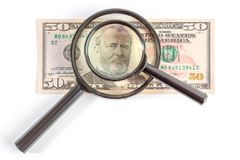 Magnifying glass placed on Ulysses S. Grant portrait. stock photo