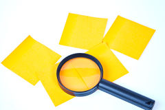 Magnifying glass and the post-it Stock Photos