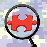 Magnifying glass puzzle Royalty Free Stock Photography