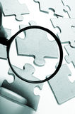 Magnifying glass, puzzle Royalty Free Stock Photography