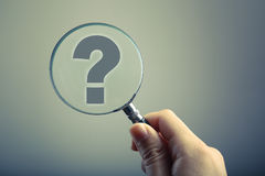 Magnifying Glass With Question Mark Royalty Free Stock Image