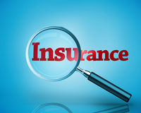 Magnifying glass revealing the word insurance written in red Royalty Free Stock Photos